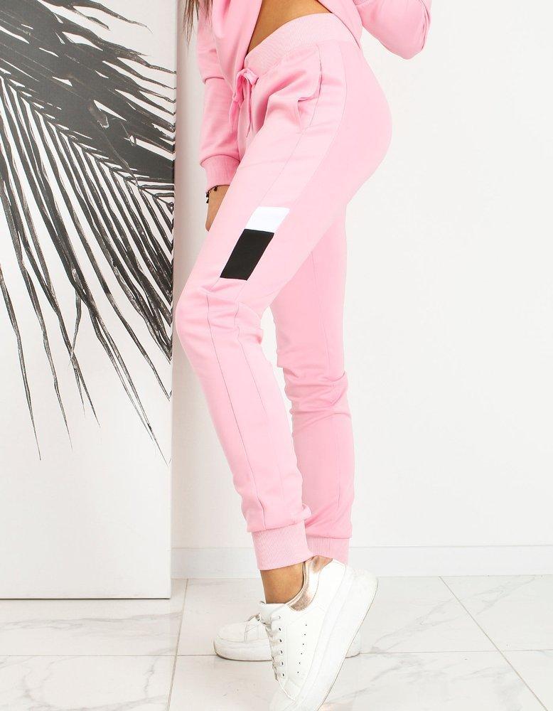 Spodnie damskie dresowe MODY różowe UY0655